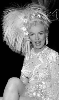 "Marilyn Monroe on set in her full costume for her musical number ""After You Get What You Want You Don't Want It"" in the movie ""There's No Business Like Show Business.""  [1954]"