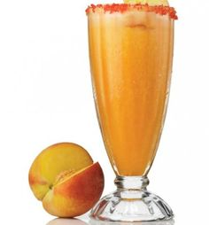 ULTIMATE PEACH PUNCH    Recipe:  1 ½ oz Ultimat Vodka  Splash of peach schnapps  Ice cubes  Peach sorbet  Lime juice  Peach-flavored sugar  Fresh peach slices for garnish    Pour Ultimat Vodka into a blender. Add a splash of schnapps, sorbet, and ice cubes. Pour into a serving glass rimmed with peach sugar. Garnish with peach slices.