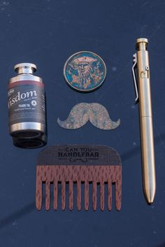 A few of my favorite things!  Pen from @karaskustoms Copper coin and moustache from @marksblades Wooden comb and flasks from the best beard oil company in the world 😉