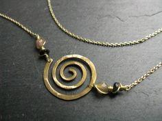 Classic spiral, minimal interlock  geometric necklace in golden brass