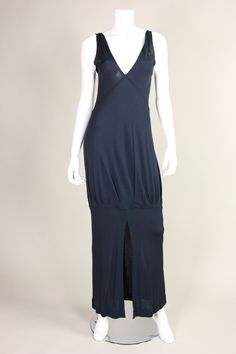 """1970's Jean Muir Matte Jersey Dress. """"1970s navy matte jersey; plunging front and a back v-neck; sleeveless; pleats in skirt above knee creates fullness; unlined; no closures."""" Priced at $895. 