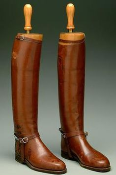 textiles & clothing, England, A pair of English Maxwell leather riding boots with wooden molds and chrome-plated spurs. Brass-mounted tops m...