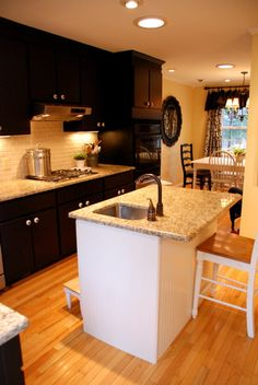 Love, love, love this kitchen. Owner painted oak cabinets BLACK! Stunning :)