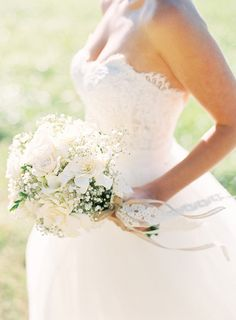 Gardenia / white roses / baby's breath - Ashley & Peter | Classic Wedding with Baby's Breath and Toile captured by Adam Barnes - via snippetandink