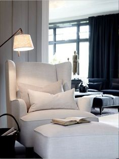 Can't go wrong with a white wing chair, matching ottomanand a brass floor lamp to create theperfect reading nook.