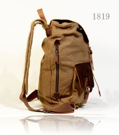 New Unisex Genuine Leather and Canvas Backpack by EAZObyZiJun