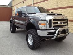 '08 F250 Southern Comfort Edition with a tough bull bar, sweet fender flares and off-road lights.