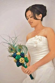Brides cascading peacock bouquet in green,blue & natural. www.flaxation.co.nz