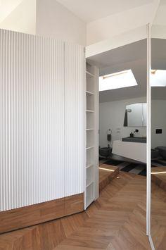 #tissellistudio white closets, wooden floor and a white/grey