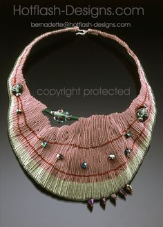 """Bernadette Mahfood-Watermelon  Knotted Fiberwork with Flameworked Beads  """"As Bernadette's work has evolved it has become more narrative in nature. She thinks of each piece as a sculpture with a story, whether a glass tile or a piece of jewelry.""""...""""The glass and fiber work have become her vehicle for expressing that inner being"""""""
