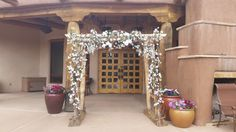 Our wedding arch can be decorated to fit any wedding - here it is with lots of white flowers