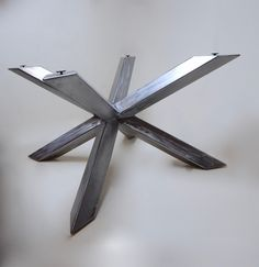 This table base is as unique as it is unusual. As simple as it looks, this piece is highly technical to fabricate. Depending on the finish you select, this piece can be anything from modern to industrial. Made out of 4x4 square steel tubing, each piece appears to cross through the other, expertly aligned in a full cross. Top is not included. Pricing shown is for standard dimensions of 42x42x29. Custom dimensions available. For long rectangular table tops, see https://www.etsy.com&#x...