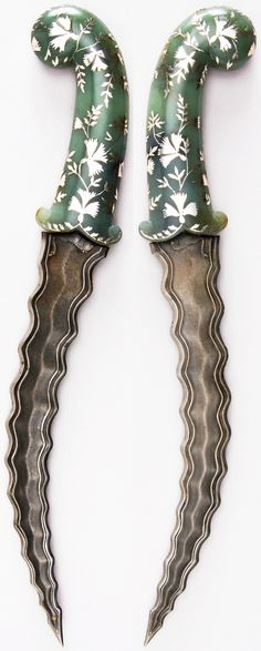 Indian dagger, 18th century, steel, jade, silver, H. 13 13/16 in. (35.1 cm); H. of blade 9 in. (22.9 cm); W. 2 13/16 in. (7.1 cm); Wt. 13.1 oz. (371.4 g), Met Museum, Bequest of George C. Stone, 1935.