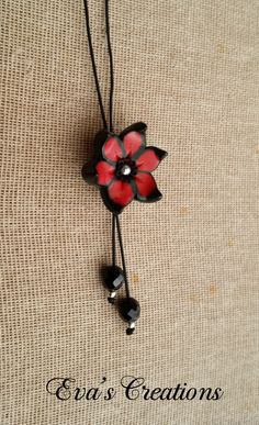 Long black and red flower necklace