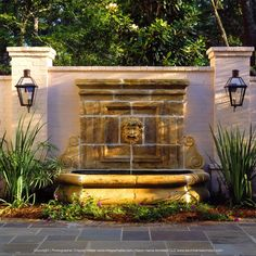 Backyard fountain from southern estate. Designed by Kevin Harris Architect, LLC. Photographed by Chipper Hatter.  #southern #architecture