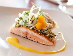 This pistachio curry crusted salmon, with avocado butter, and cumin vinaigrette comes courtesy of Executive Chef Augustin Saucedo of Sycuan Golf & Tennis Resort in San Diego. This light entree is easy to make at home for a family dinner or social