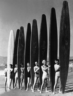 1940s... will you look at the size of these surf boards lol. So cumbersome and they prob weigh a ton.