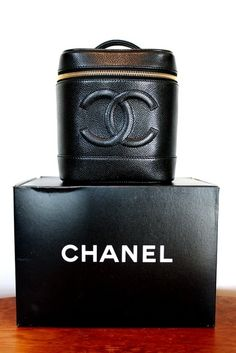 Chanel Black Pebbled Leather Cosmetic Travel Bag - Hmmmm I love this...going to look for it.