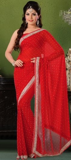Take the fashion industry by storm in this beautiful embroidered saree.   This red georgette saree have beautiful embroidery patch work which is embellished with sequins, cutdana and stone work.   Fabulous designed embroidery gives you an ethnic look and increasing your beauty.   Matching blouse is available.   Slight Color variations are possible due to differing screen and photograph resolutions.
