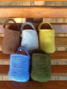 Doorknob organizer baskets, crocheted in soft acrylic earth tone shades of olive, brown, yellow, blue or grey, single or as set