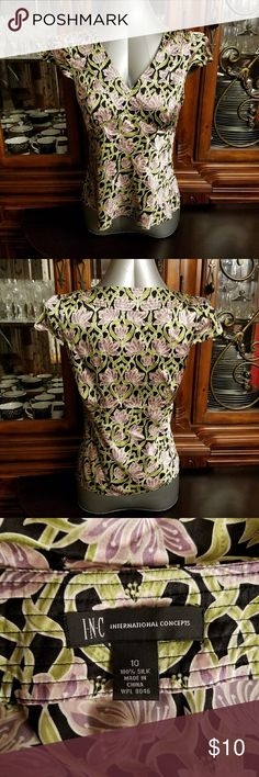 Silk Top from INC Memorial Weekend Sale! Price goes back up after Memorial Day. Very cute, 100% silk, quarter sleeve top from INC. Side zipper. Light green and light purple floral pattern. Great for spring/summer. The tag says size 10 but I believe it runs a little small. I think it would be a better fit for someone size 6/8. INC International Concepts Tops Blouses