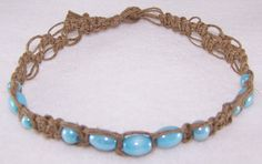 Hemp Necklace handcrafted by Moon Goddess Jewelry. Created with dark brown hemp and aqua colored glass beads.