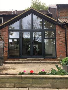 ALUK aluminium French doors and windows to infill gable end