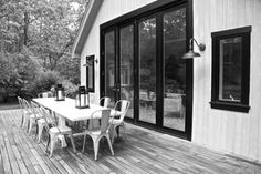 I love the black metal doors and the huge outdoor dining table