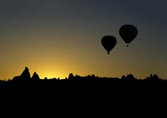 Meeting the Cappadocia's sun in balloons. by Savas Sener