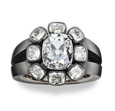 Hemmerle ring made of diamonds, black finished silver, and white gold.