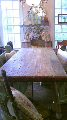 Rustic farm house table. Venetian mirror. Italian figural lamps.