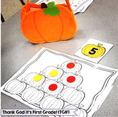 Pumpkin Math! Students pull a number and place that many counters on the pumpkins. Students must figure out how many more pumpkins need to be covered to make 10 and write the number sentence.
