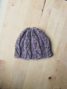 Cable knit baby hat // A pretty hat for a pretty little lady. Madelinetosh yarn…
