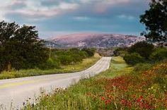 Enchanted Rock Road. An early morning shot on RR965 heading towards Enchanted Rock State Natural Area. Indian Paint Brushes in bloom along the highway. #texashighways #legendaryhighways #enchantedrock #tandemlogistics