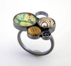 Eric Burris.  Oxidized sterling silver ring, mokume gane, found items.