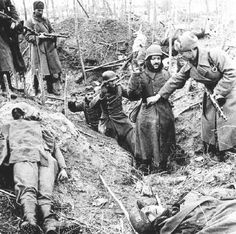 Exhausted German soldiers climb out of a bunker to a shattered landscape, dead comrades and grim captors. The Red Army had completed its surprise encirclement of 300,000 Nazi troops in late November. Hitler believed that supplies could be airlifted in, refused to allow his Stalingrad commanders to organize a breakout and retreat.