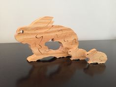 Bunny family with two removable babies. Made from walnut.