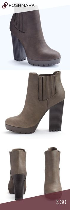 """NWT. Double gore taupe heeled boots NWT. Double gore taupe heeled boots. Features a chunky stacked heel, faux leather upper, jersey lining, round toe, slip on, padded footbed, 4.5"""" heel height, 0.5"""" platform. Comes in the original box. Sorry, no trades. Like the item but not the price, feel free to make me a reasonable offer through the offer button. Candie's Shoes Heeled Boots"""