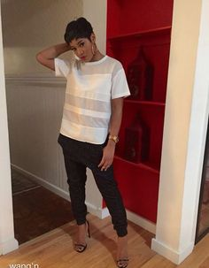 Keke Palmer casual black pants over. Sized tee white chic