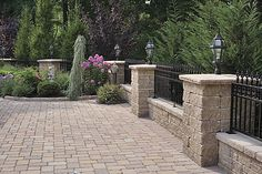 front yard patio landscaping pictures with wrought iron fencing | Pillar and Stonedge Cap Wallstone design idesa