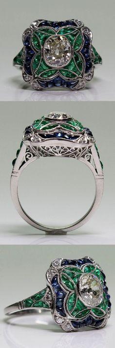 An Art Deco platinum, diamond, sapphire and emerald ring, 1920-35.