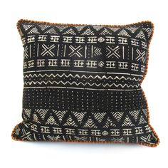 Also called bògòlanfini, African mud cloth is one-of-a-kind fabric painting. Pillow made from black and white mud cloth, backed with a heavy cotton/ linen and a textured cording finishes this one of a