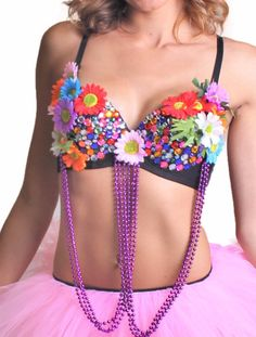 Multi-color daisies and semi-transparent rainbow rhinestones bring this rave bra to life! Comes with hanging tassels that move and sway with you as you dance! Comes in the following sizes: S/M: 32/34