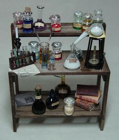 miniature apothecary | This may be for a dollhouse but I like the set up of the table, with ...