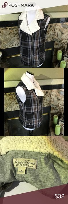 Lucky Brand Flannel vest Black, blue stripes, yellow and gray. Zipper front Zipper pockets shearling chest and color. Nice and comfortable like New perfect condition. Lucky Brand Jackets & Coats Vests