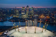The famous building in Greenwich with a lit-up Canary Wharf in background. London Docklands, London Landmarks, City Aesthetic, London Photos, City Photography, Birds Eye View, Summer Parties, London City, Beautiful Islands