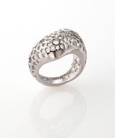Product details:  Admire the raw flowing shape of the Bombai ring up close and in great detail. Crafted from flawless 316 marine grade steel, this ring is highlighted with the starry Arabesque pattern in a stunning see through design.  Wear this ring during an evening event for beautiful finish.   MATERIAL 316 Marine Grade Stainless Steel. Weight 0.01 lb