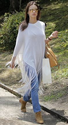 Alessandra Ambrosio running errands in Los Angeles, CA (May 15, 2015), wearing a Minnie Rose Fringe Hankie Poncho, a MICHAEL Michael Kors Riley Small Satchel bag and  Saint Laurent Blake Suede Ankle Boots. #alessandraambrosio #style
