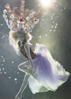 Underwater Fashion photography by Mick Gleissner. S, I love the pose and ghostly look of this photo.