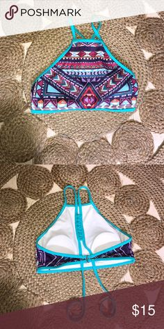 Bikini Top Super cute PacSun bikini top it's LA Hearts , can fit either small or medium, I love the back never got to wear it and it's in perfect condition. Use it at the beach , pool , boat even with some shorts and you could use it for a festival ! PacSun Swim Bikinis